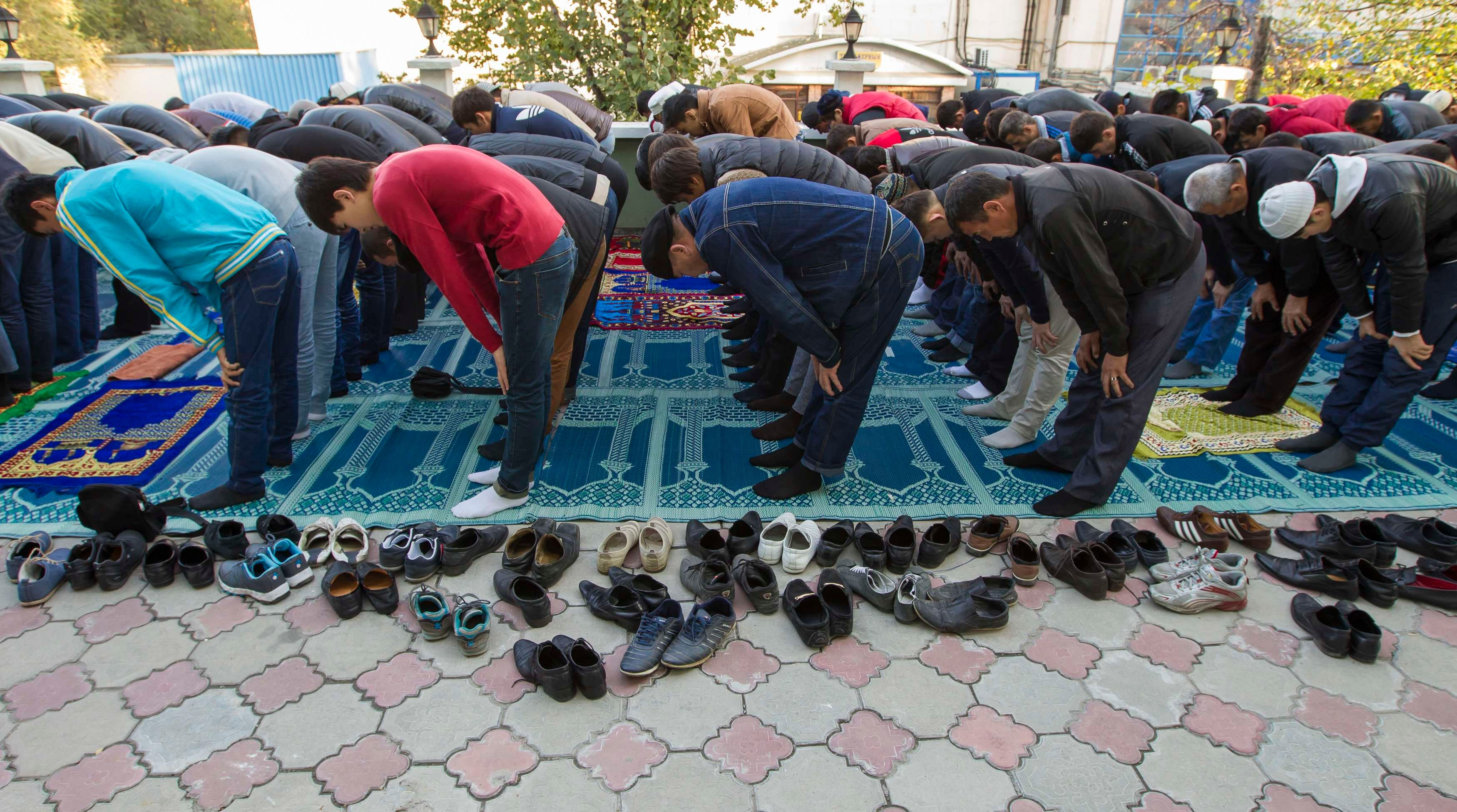 KAZAKHSTAN: Muslims pray during Kurban-Ait, also known as Eid al-Adha in Arabic, in a mosque in Almaty October 15, 2013. (Reuters)