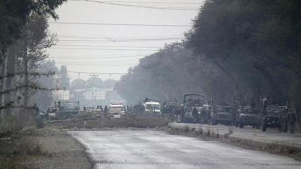 Soldiers are seen at an isolated army checkpoint after it was attacked by militants at Lakki Marwat in the outskirts of Dera Ismail Khan February 2, 2013.