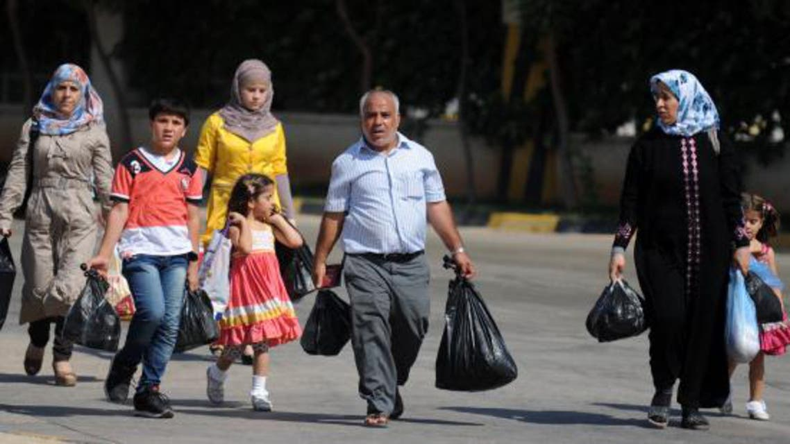 Amnesty said hundreds of refugees who fled Syria, including scores of children, face ongoing detention in poor conditions or deportation. (File photo: AFP)