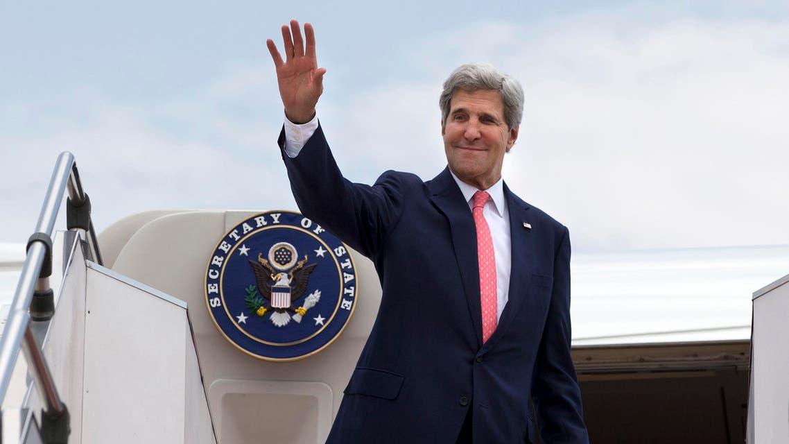 Kerry Reuters waving