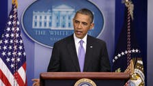 Obama signs bill ending shutdown, averting U.S. debt default