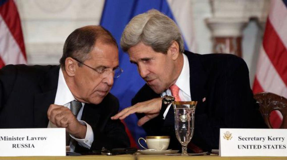 Russian Foreign Minister Sergey V. Lavrov (L) talks with U.S. Secretary of State John Kerry during a meeting at the U.S. State Department on August 9, 2013 in Washington, DC. AFP