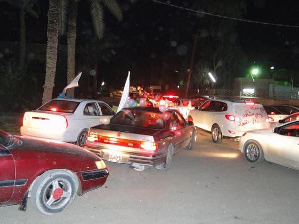 """العراقيون يستقبلون الحجاج بـ""""الكليجة"""" والفرق الموسيقية"""