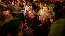 Lebanese freed by Syrian rebels in hostage swap arrive home