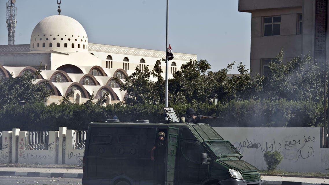 An Egyptian riot police van is seen during clashes with student of the al-Azhar University outside their university camps in Cairo, on October 20, 2013, during an anti-army protest.  afp