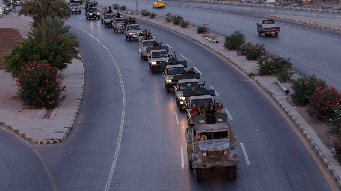 Groups of revolutionaries drive their vehicles along a road in Tripoli September 21, 2013. (Reuters)
