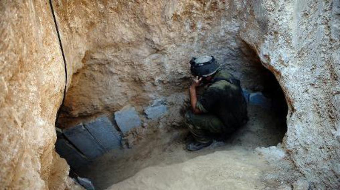 An Israeli soldier at the entrance of a tunnel reportedly dug by Palestinians beneath the border between the Gaza Strip and Israel and recently uncovered by Israeli troops, on October 13, 2013 (AFP/