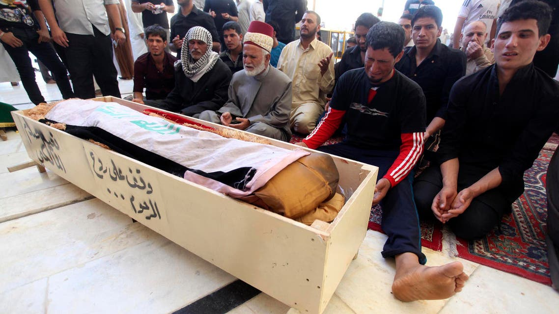 Iraqis mourn deadly attacks