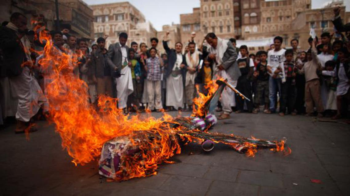 Demonstrators in Yemen burn an effigy of a U.S. aircraft during a demonstration to protest against what they say is U.S. interference in Yemen, including drone strikes. (File photo: Reuters)