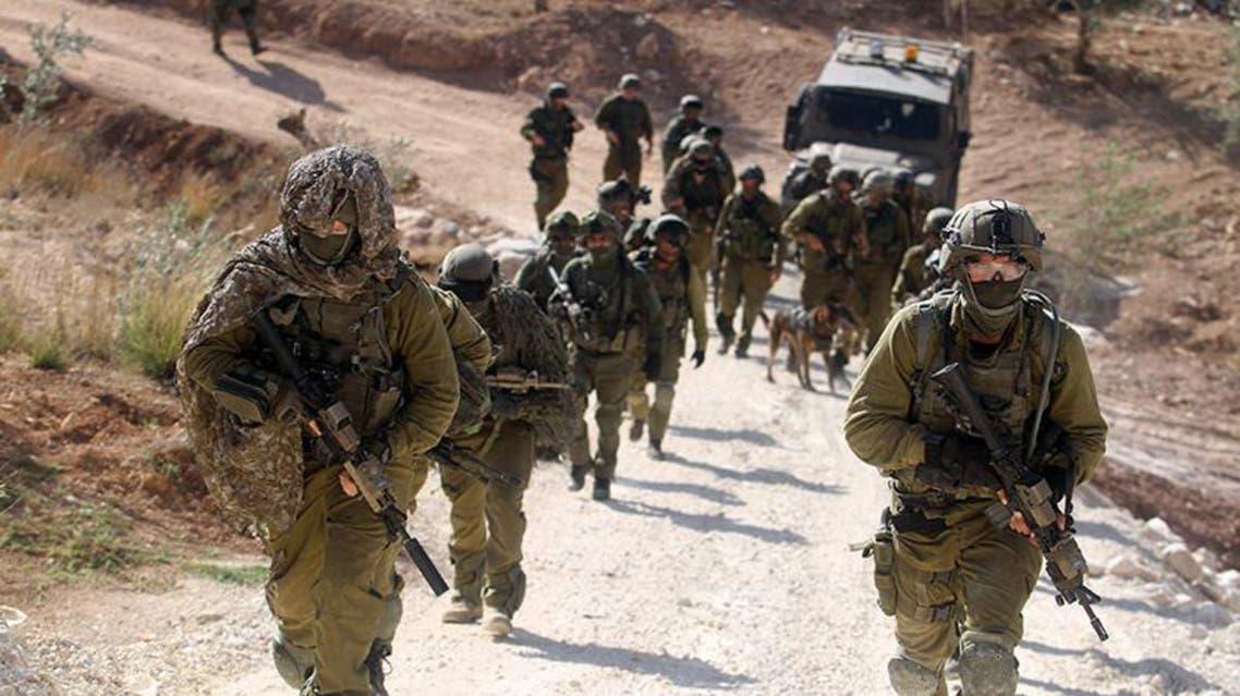 قوات اسرائيلية في موقع الاشتباك بالقرب من مدينة رام الله