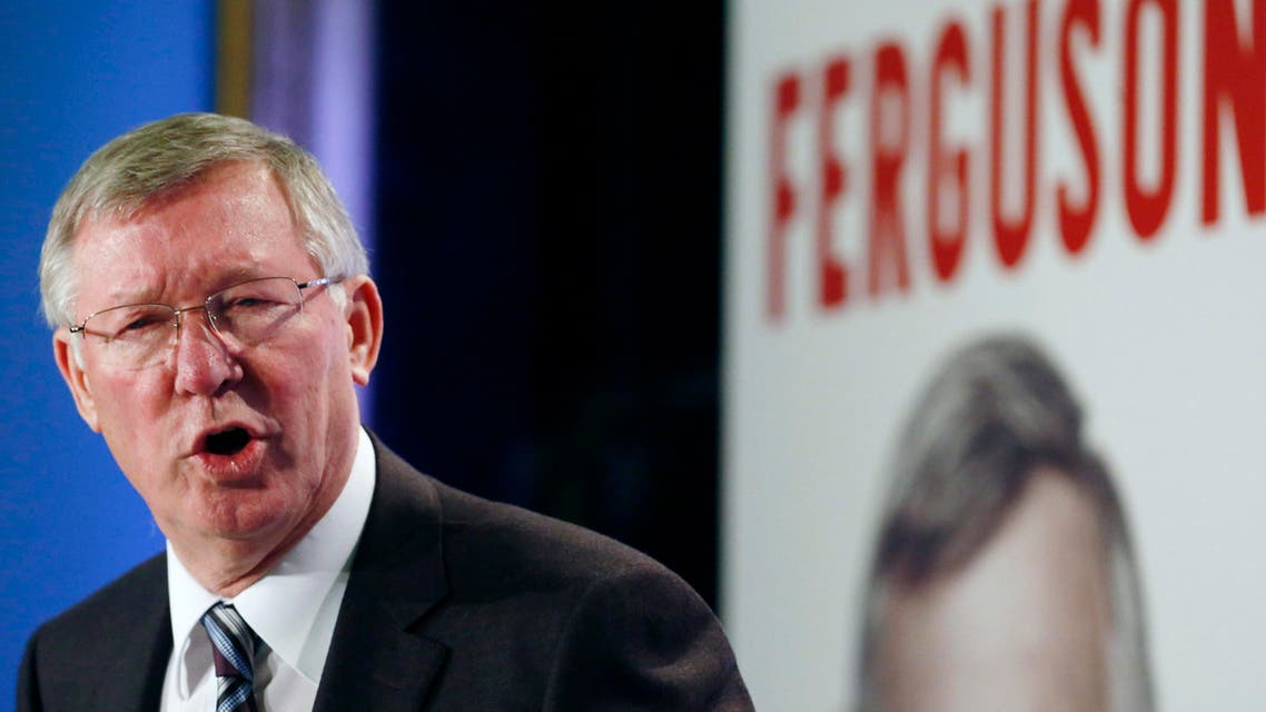 Former Manchester United manager Alex Ferguson reacts before a news conference about his new autobiography at the Institute of Directors in London October 22, 2013.
