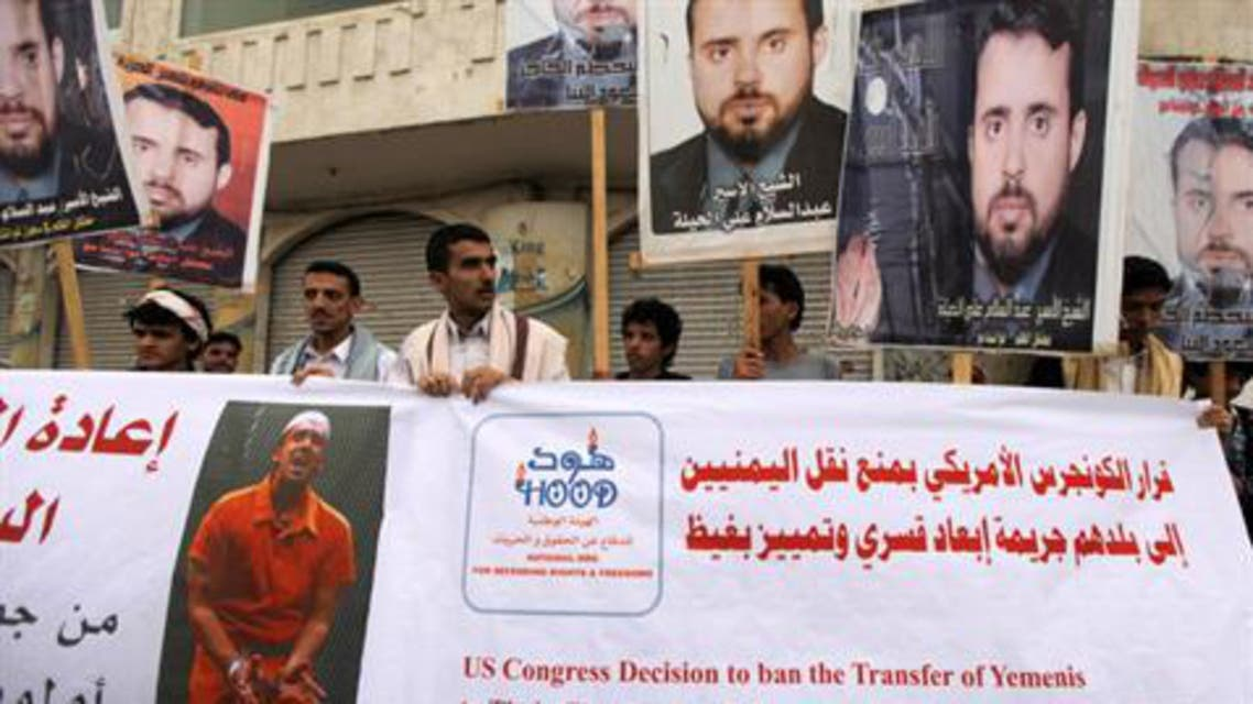 Sana'a protesters hold banners with pictures of what they say are Yemeni detainees at the Guantanamo. (File photo: Reuters)