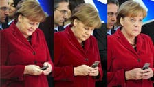 Germany summons U.S. envoy over Merkel phone spy suspicion