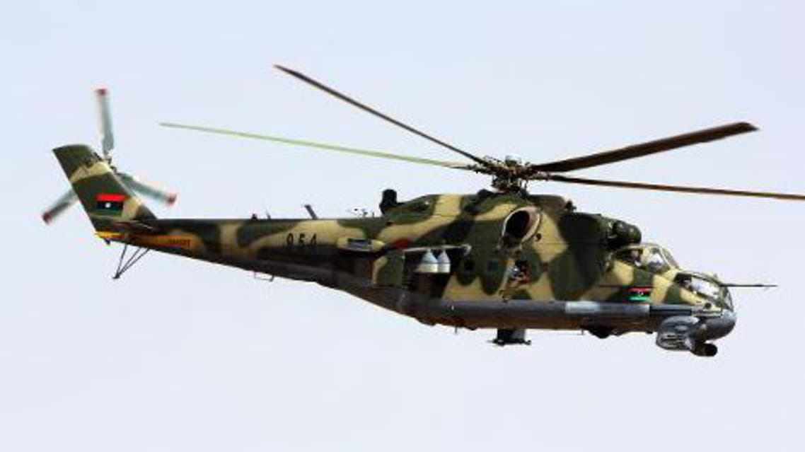 A military attack helicopter flies over Benghazi during a parade on March 19, 2013. (File Photo: AFP)