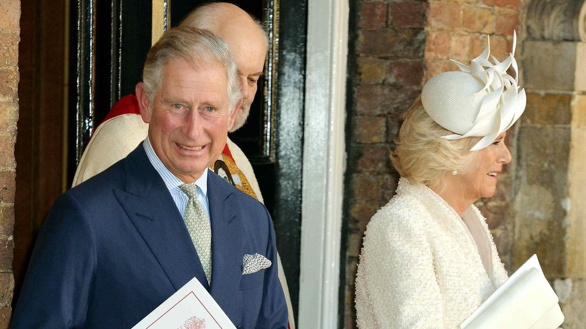 Britain's Prince Charles and his wife Camilla, Duchess of Cornwall leave after the christening of Prince George at St James's Palace in London October 23, 2013. reuters