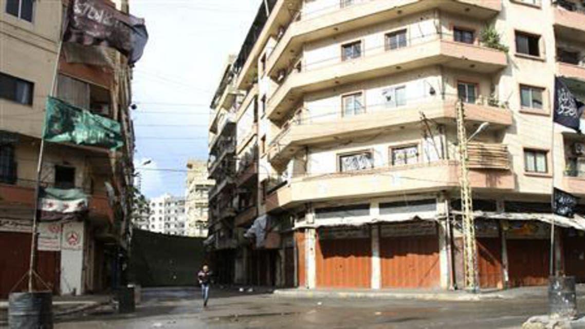 tripoli reuters A civilian runs to take cover in the Sunni Muslim Bab al-Tebbaneh