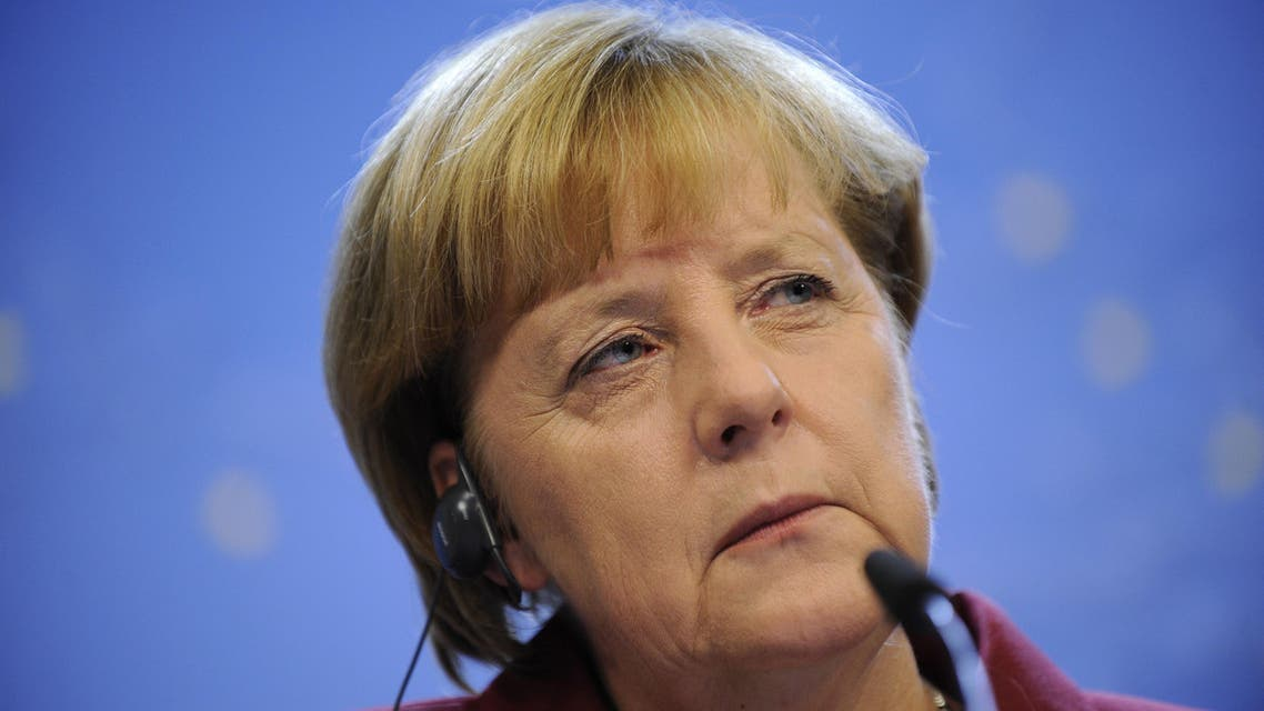 German Chancellor Angela Merkel listens at a joint press conference on October 24, 2013 in Brussels.  afp