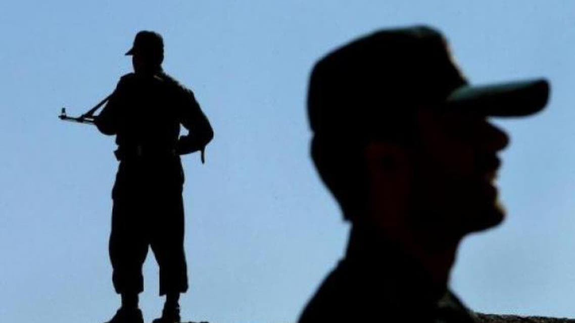 This file photo shows Iranian soldiers standing guard near the border with Pakistan and Afghanistan. (AFP)