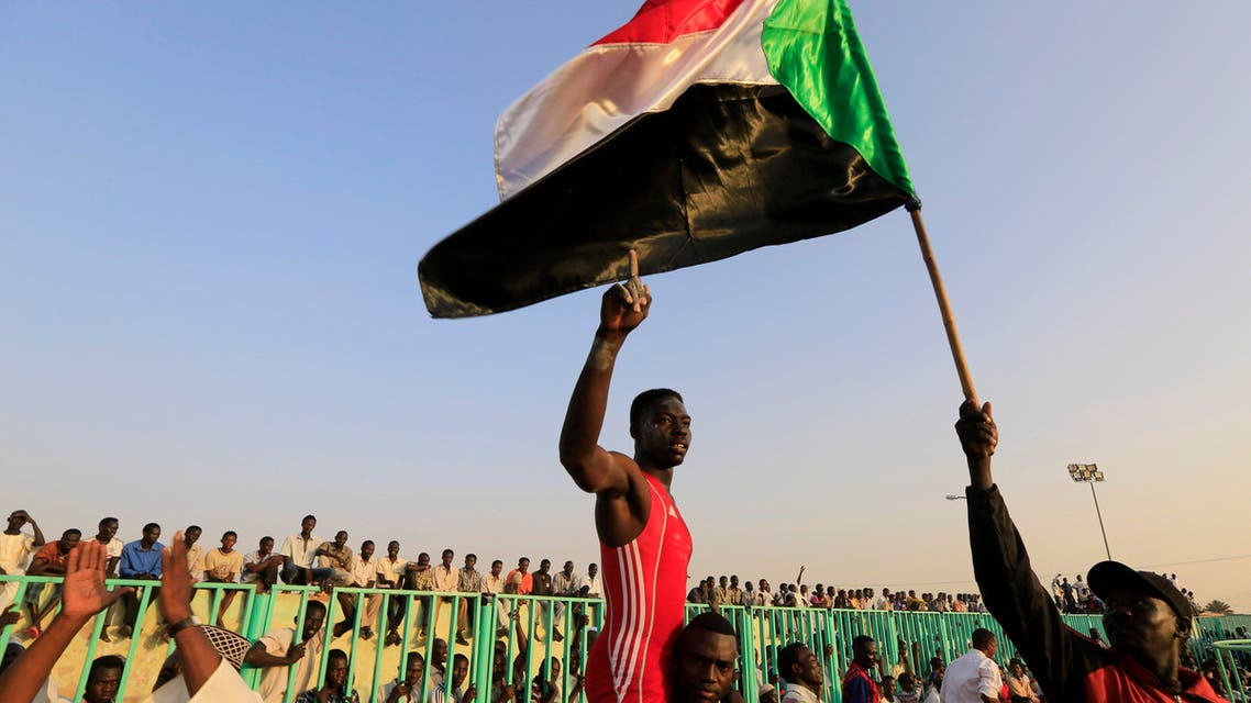 Japanese diplomat takes on Sudanese wrestler