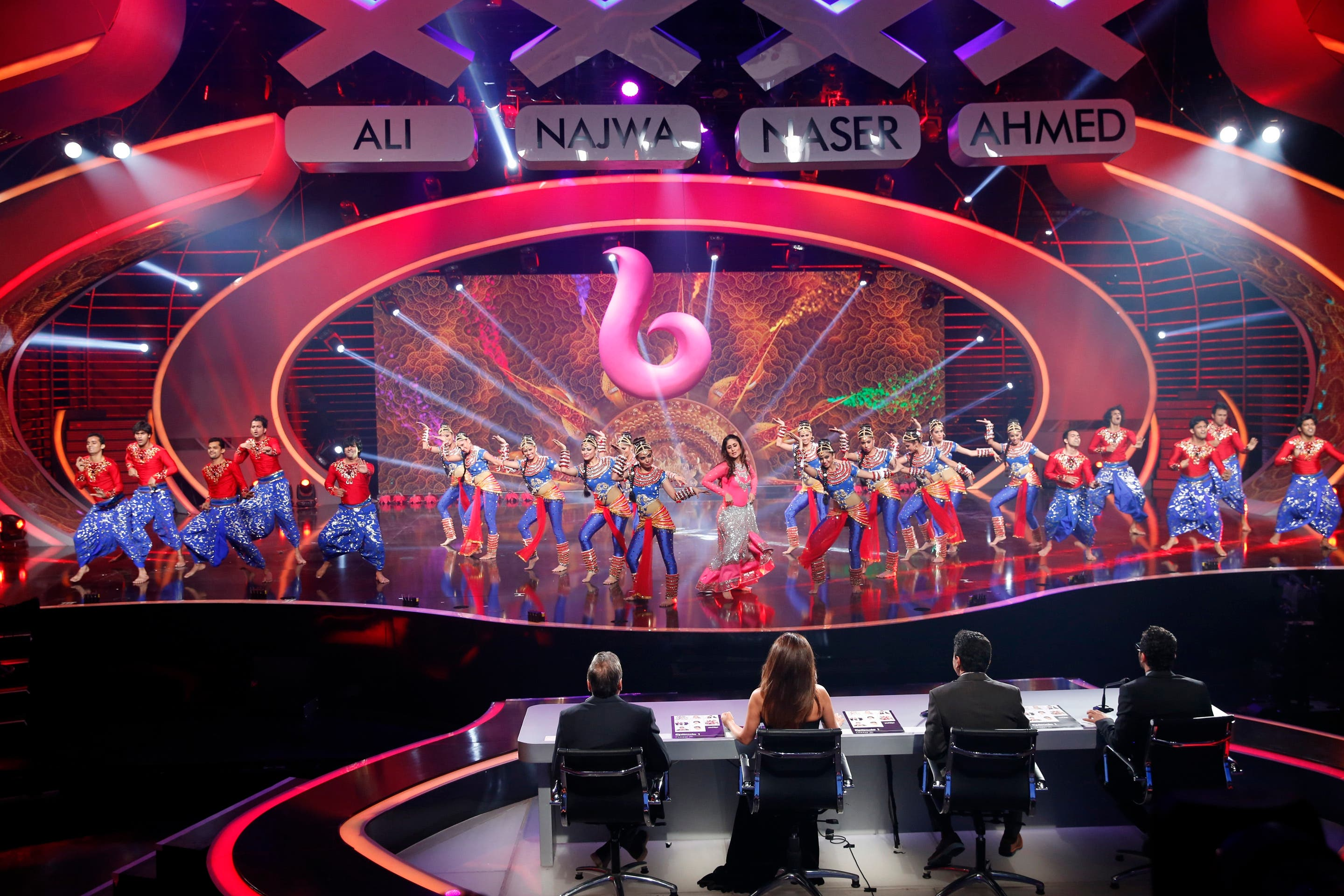 Arabs Got Talent stage lit up colorfully as Karina Kapoor performed on it along with back-up dancers. (MBC)