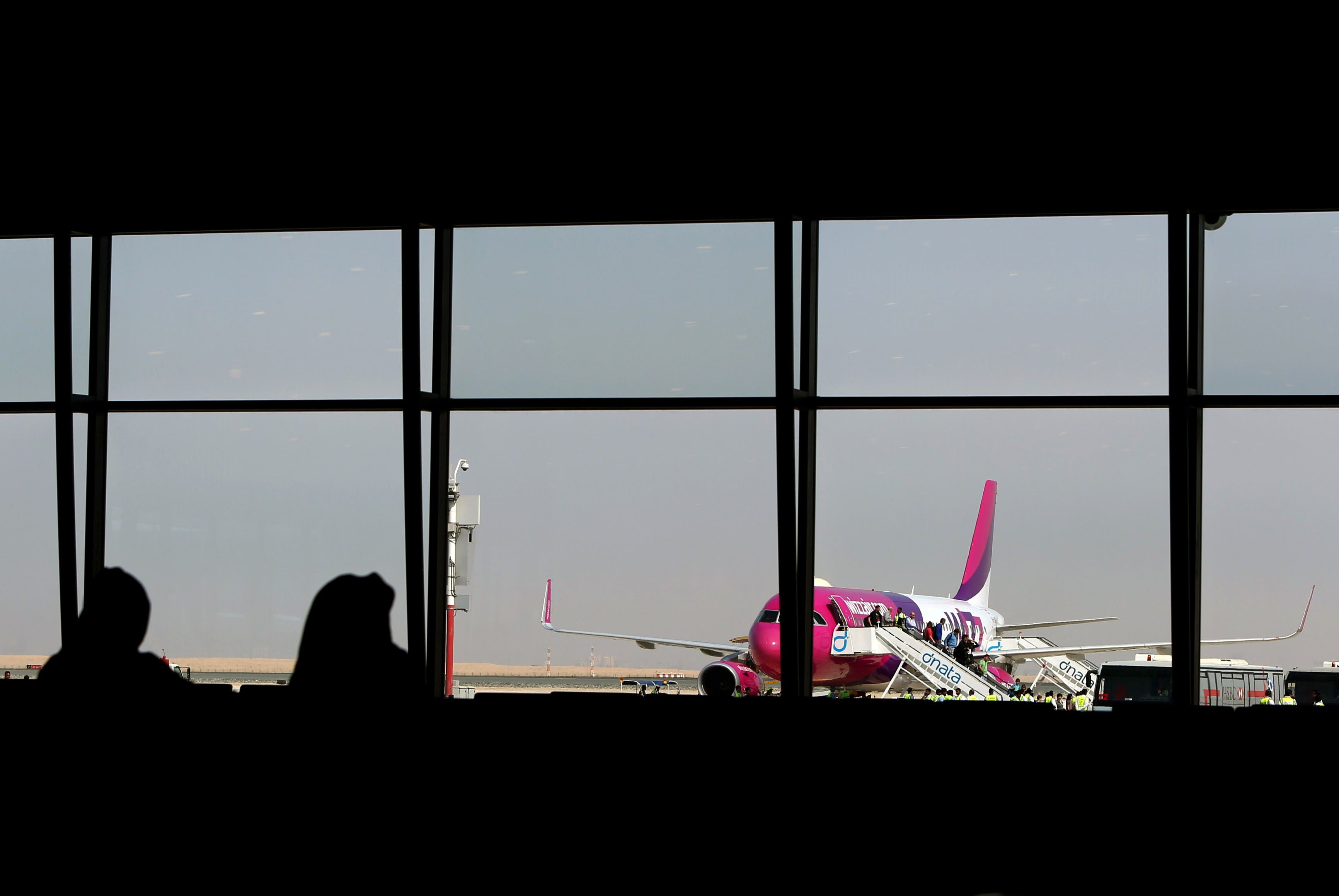 Passengers disembark from a Wizz Air flight at the newly opened Al-Maktoum International airport in Dubai, on October 27, 2013. (AFP)