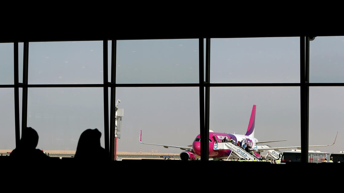 Passengers disembark from the low cost Hungarian Wizz Air at the newly opened Al-Maktoum International airport, the emirate's second airport in Dubai, on October 27, 2013. (AFP)