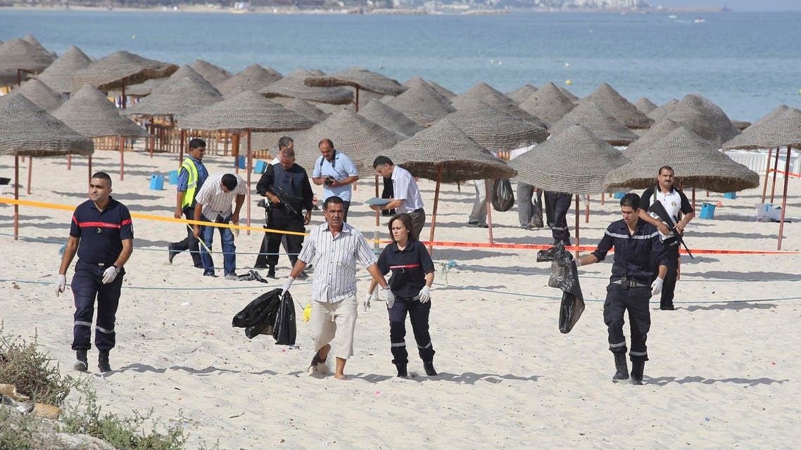 Tunisian policemen investigate near a crime scene on a beach near the tourist resort of Sousse Oct. 30, 2013. (Reuters)