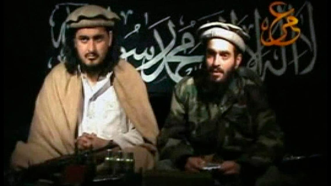 Taliban leader Hakimullah Mehsud (L) sits beside a man who is believed to be Humam Khalil Abu-Mulal al-Balawi, the suicide bomber who killed CIA agents in Afghanistan, in this file still image taken from video released Jan. 9, 2010. (Reuters)