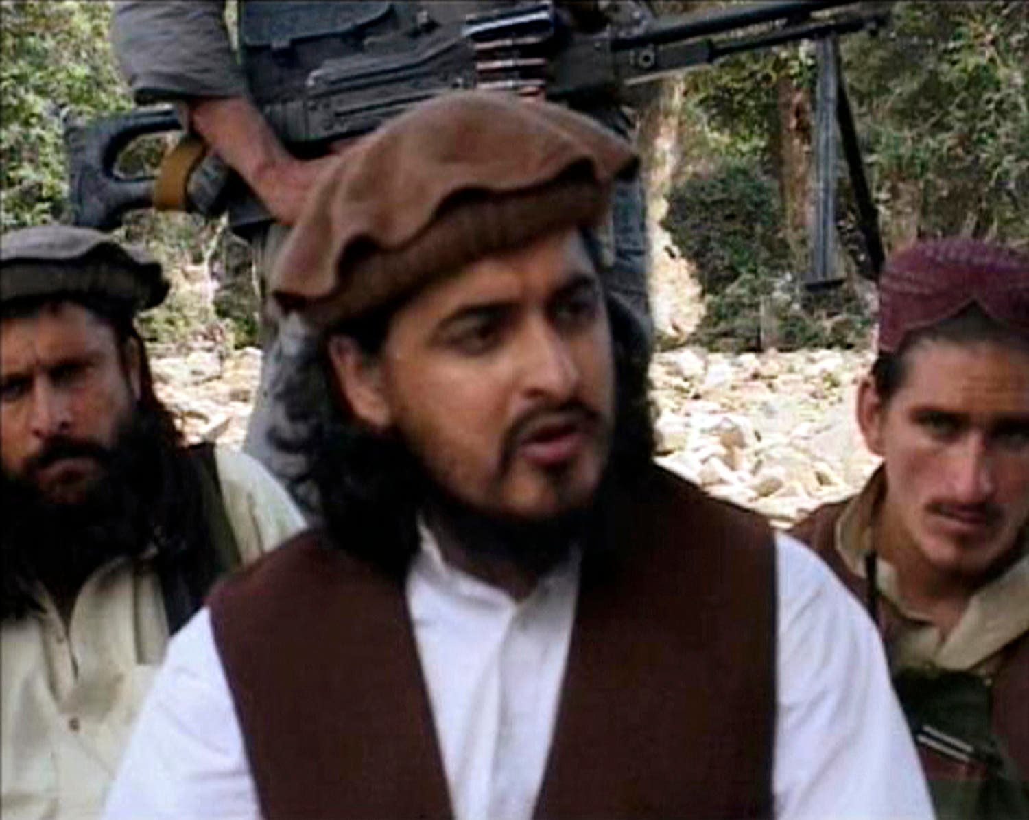Pakistani Taliban chief Hakimullah Mehsud (C) sits with other militants in South Waziristan, in this file still image taken from video shot October 4, 2009 and released Oct. 5, 2009. (Reuters)