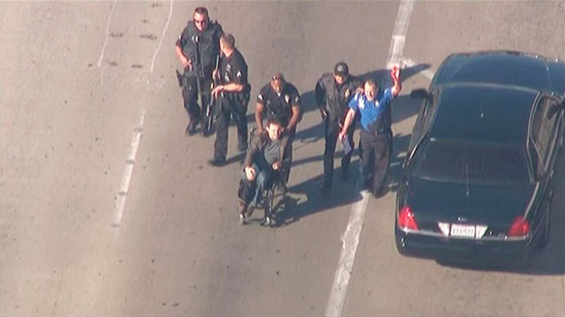 Police escort a man in a wheelchair toward medical help during an incident in which shots were fired at Los Angeles International Airport in Los Angeles in this still image taken from video provided by KNBC Nov. 1, 2013. (Reuters)