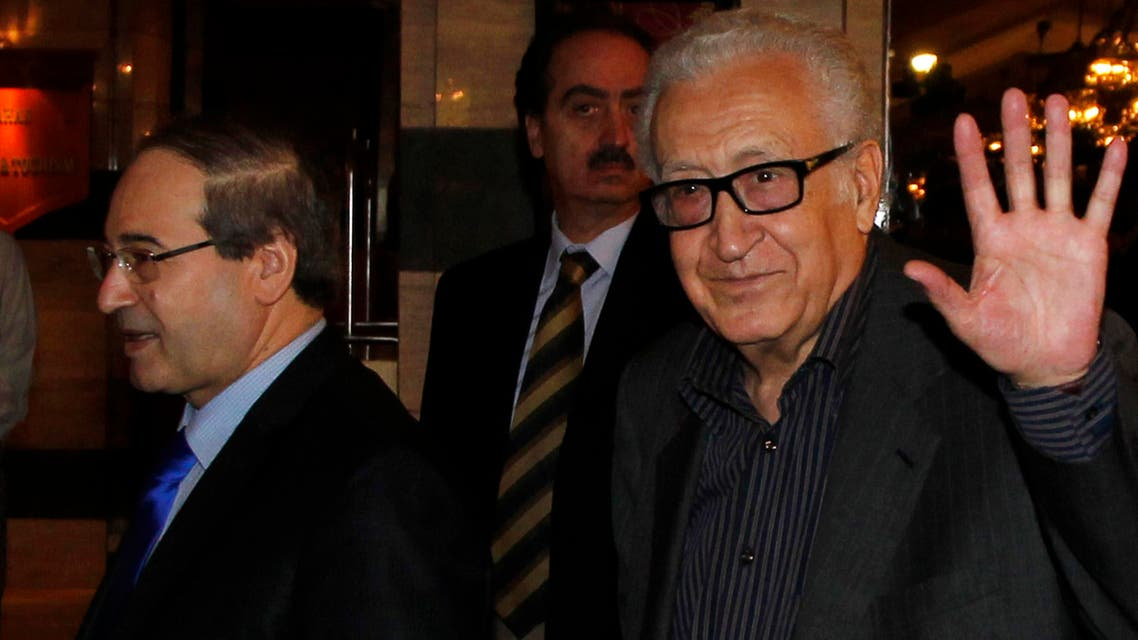 United Nations Peace Envoy for Syria Lakhdar Brahimi (R) waves to journalists during his arrival at a hotel in Damascus Oct. 28, 2013. (Reuters)