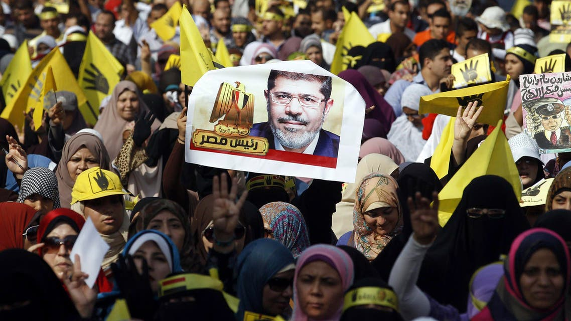 Supporters of the Muslim Brotherhood and ousted Egyptian President Mohammad Mursi take part in a protest against the military and interior ministry in a suburb on the outskirts of Cairo, November 1, 2013. (Reuters)