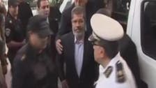 Egypt's ousted President Mursi goes on trial and challenges the court
