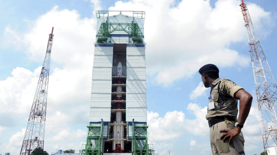 This photograph shows an Indian security forces member keeping watch near the PSLV-C25 launch vehicle, carrying the Mars Orbiter probe as its payload, at the Indian Space Research Organization facility in Sriharikota. (AFP)