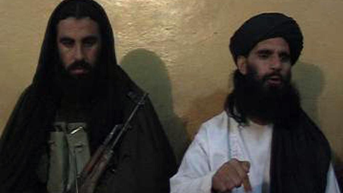 Smatullah Shaheen (R) caretaker chief Tehreek-e-Taliban Pakistan (TTP) announcing the new leader of TTP during a press conference in an undisclosed location in northwest Pakistan. (AFP)