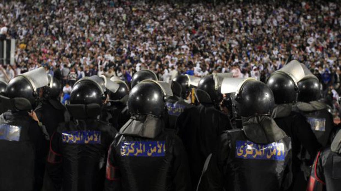 Egyptian riot police stand guard in Cairo Stadium during the first half of an earlier match between Zamalek and Ismaili clubs in Cairo. (File photo: AFP)