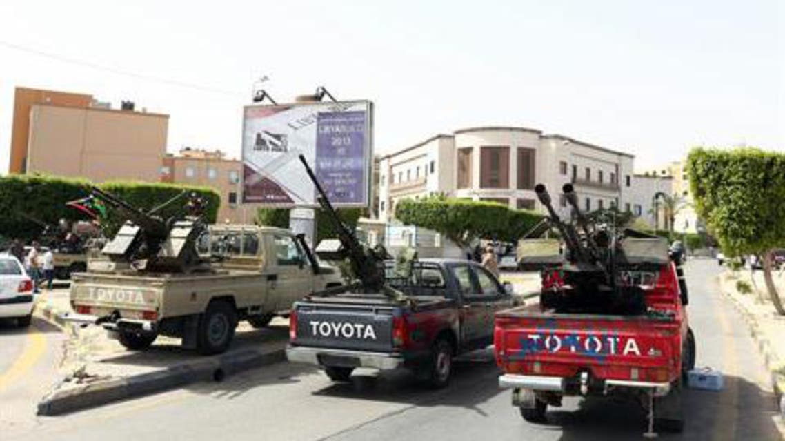 ehicles, mounted with anti-aircraft guns, are parked outside the foreign ministry on April 28, 2013 in the Libyan capital Tripoli. AFP PHOTO MAHMUD TURKIA