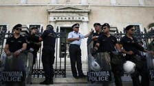 Greek riot police storm former state TV building, evict protesters