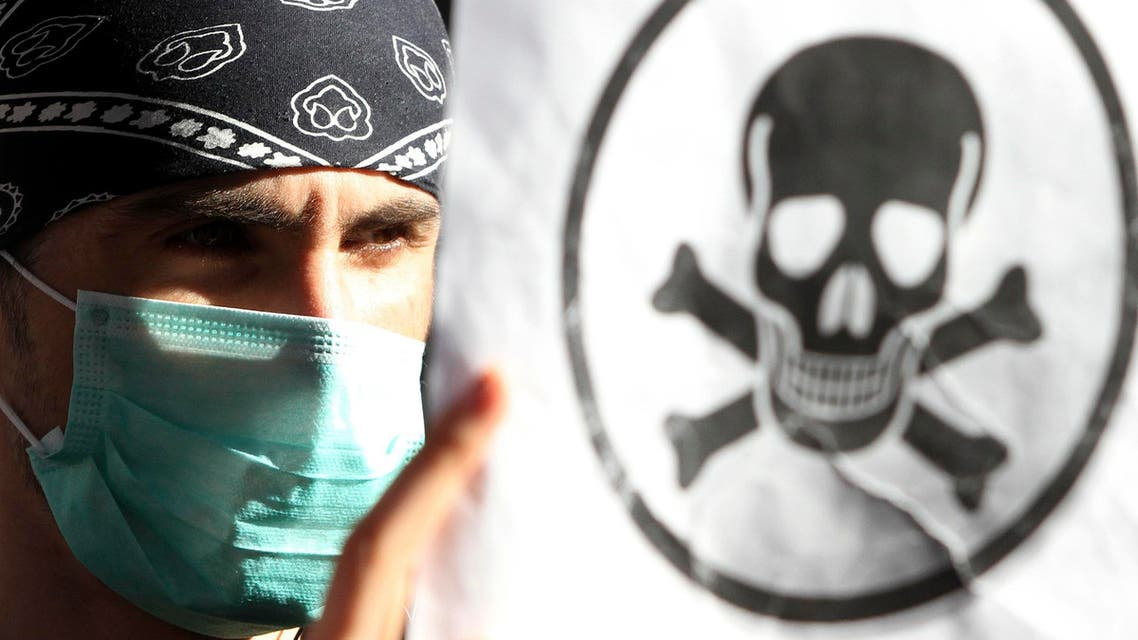 A demonstrator protests against the dismantling of Syrian chemical weapons in Albania in front of the Prime Minister's office in Tirana November 7, 2013. Reuters