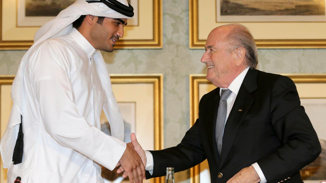 FIFA President Sepp Blatter (R) shakes hands with Qatar's 2022 World Cup Bid Chief Sheikh Mohammed al-Thani (L) at a news conference in Doha Nov. 9, 2013. (Reuters)