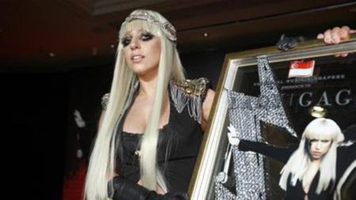 U.S. singer Lady Gaga poses with a plaque presented to her by Universal Music Group during a media event. (File photo: Reuters)