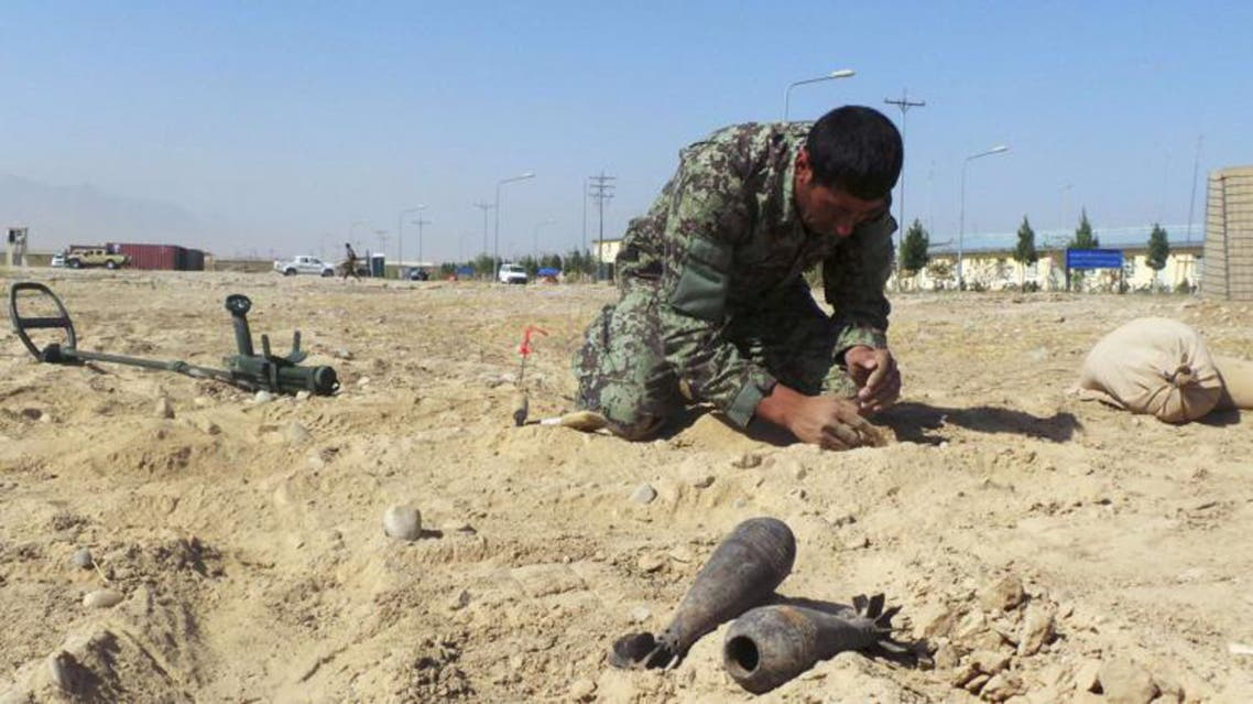 An Afghan army soldier from an improvised explosive devices (IED) school performs a demonstration in Mazar-e-Sharif in northern Afghanistan, October 5, 2013.  reuters