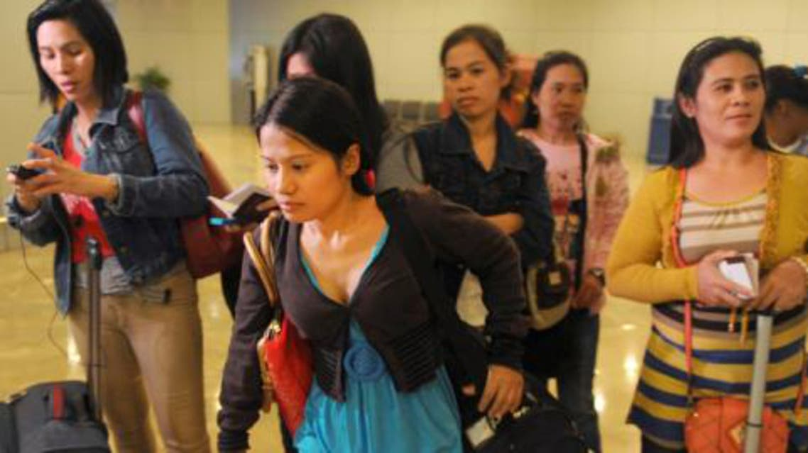 Some of the 30 repatriated Filipino workers arrive at Manila airport. Photo: AFP