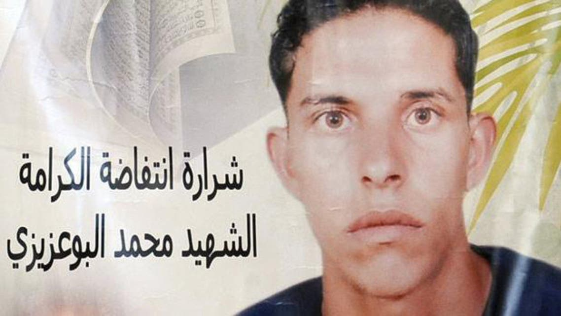 A poster featuring Mohamed Bouazizi, the Tunisian fruitseller whose self-immolation in December 2010, ignited the Arab spring. PhotoAFP