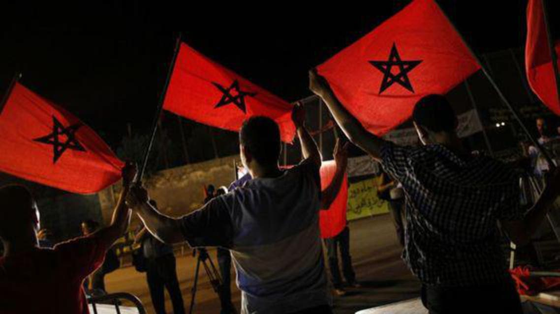 Moroccans from a human rights association hold Moroccan flags during a protest on the border with Spain over immigration and other issues in Nador, northern Morocco. (File photo: Reuters)