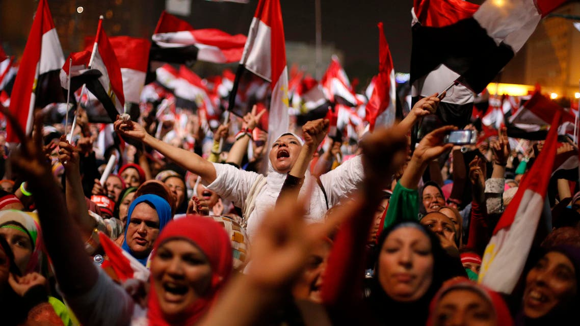 Protesters, who are against Egyptian President Mohamed Mursi, react in Tahrir Square in Cairo July 3, 2013. (Reuters)
