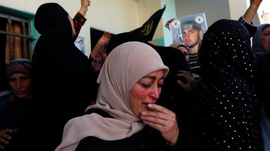 Palestinian mourners seen at the funeral of Mohammed Assi in Beit Liqya, a village near Ramallah, the West Bank. (Reuters)