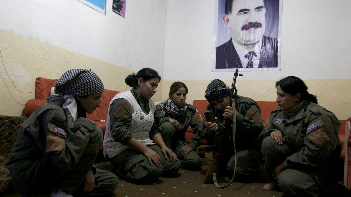 Female members of the Kurdish police, also known as Asayis, sit together as a fellow member trains them on how to use a weapon at their headquarters in Qamshli Nov. 8, 2013. (Reuters)