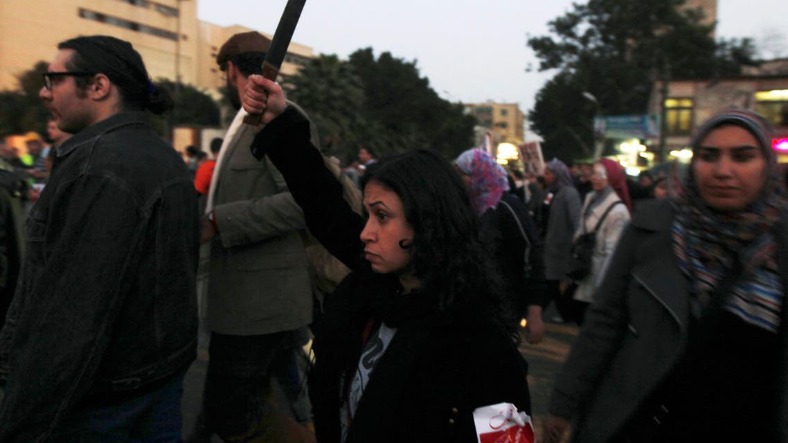 A woman raises a knife and shouts slogans against then Egyptian President Mohamed Mursi and the Brotherhood a during march against sexual harassment and violence against women in Cairo. (File Photo: Reuters)