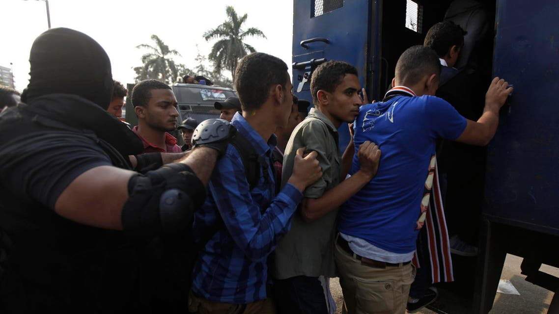 Police detain students in al-Azhar University after a student protest in Cairo October 30, 2013. (Reuters)